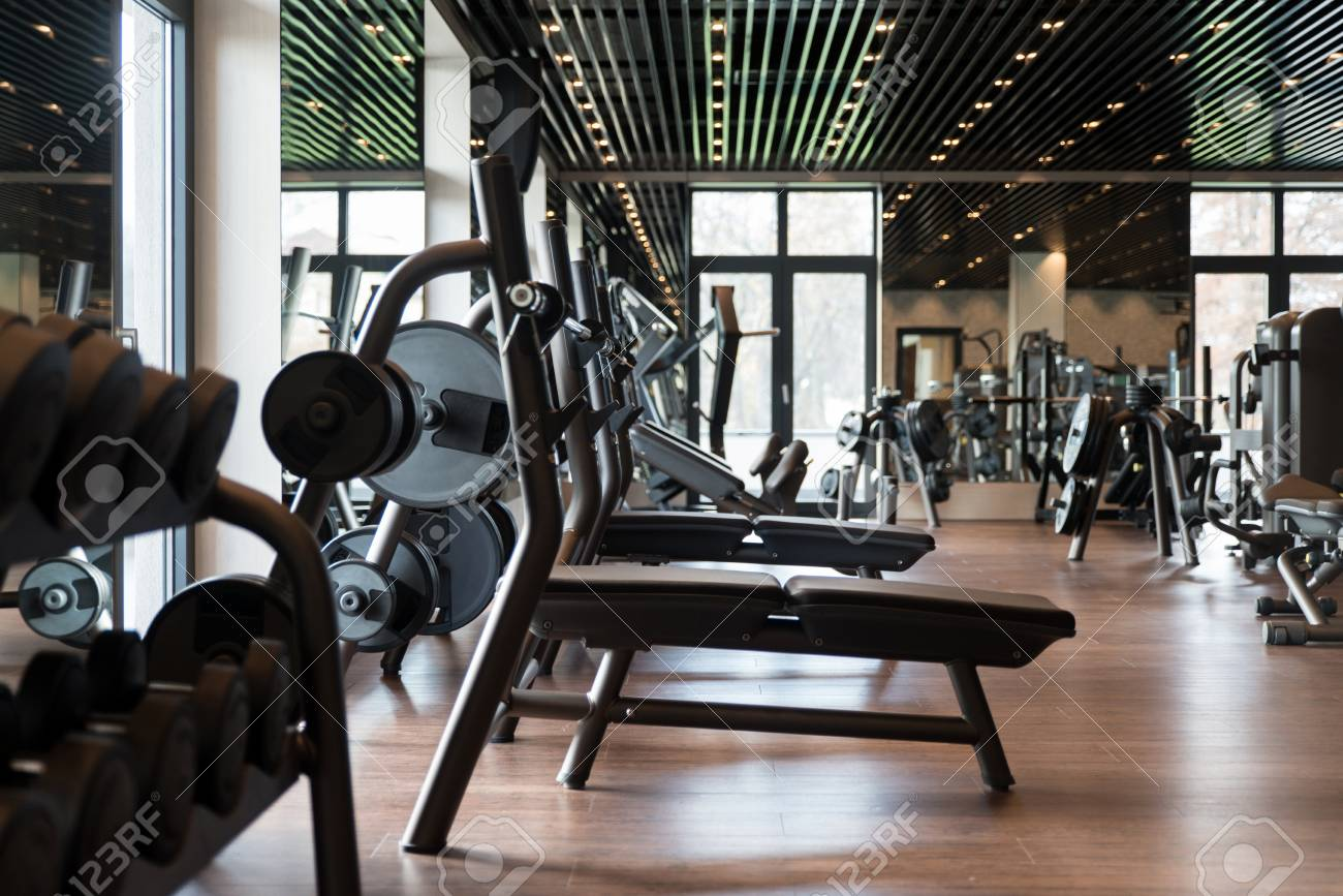 Equipment and machines at the modern gym room fitness center stock