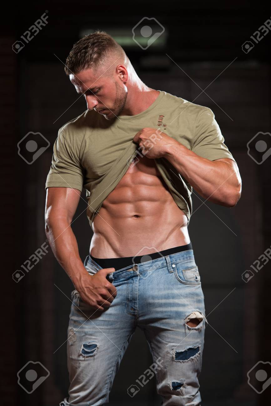 Handsome Young Man In Jeans T Shirt Standing Strong In The Stock Photo Picture And Royalty Free Image Image 71127295