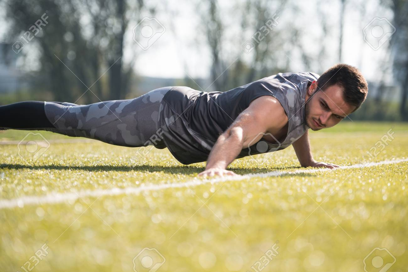 Attractive Man Doing Push Up in City Park Area - Training and
