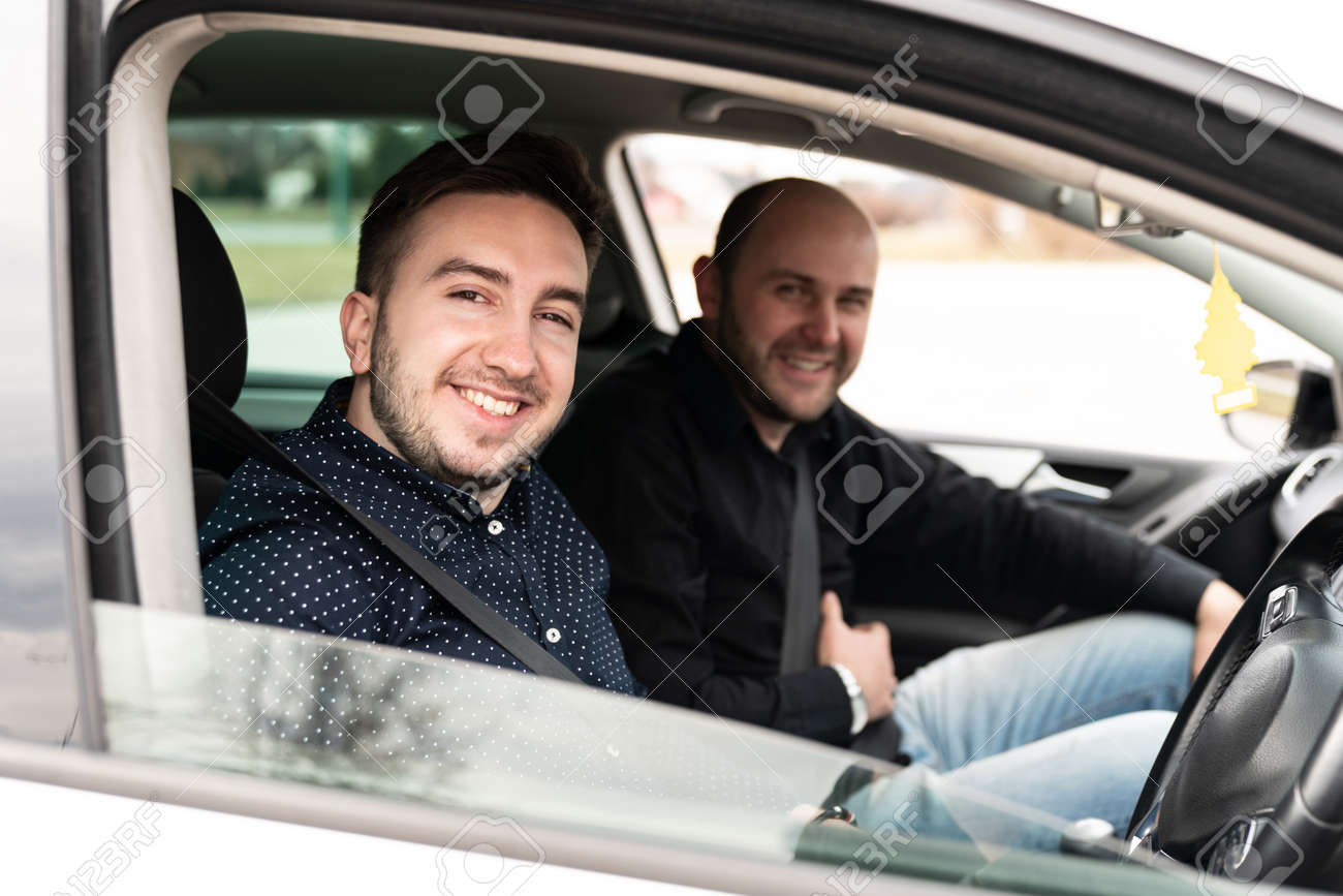 Driving Instructor and Man Student in Examination Car Testing Learner Driver - 159915227