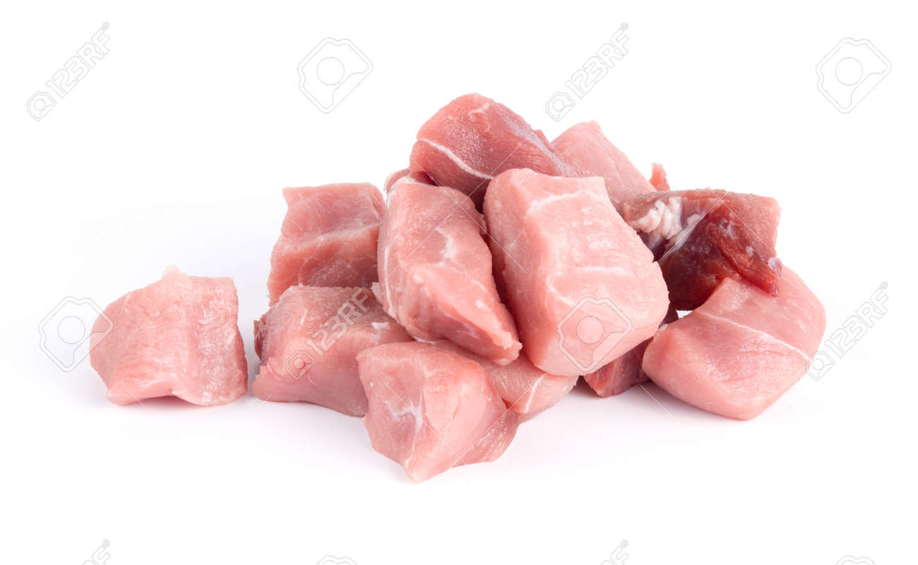 Pile of pork uncookes chopped cubes close up isolated on white background - 159143304