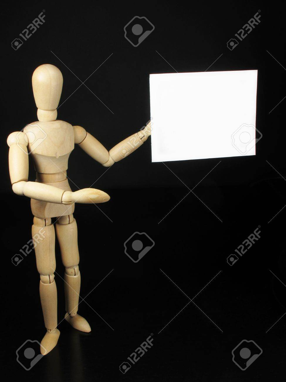a humanoid doll with black background and white sign to write things Stock Photo - 9457995