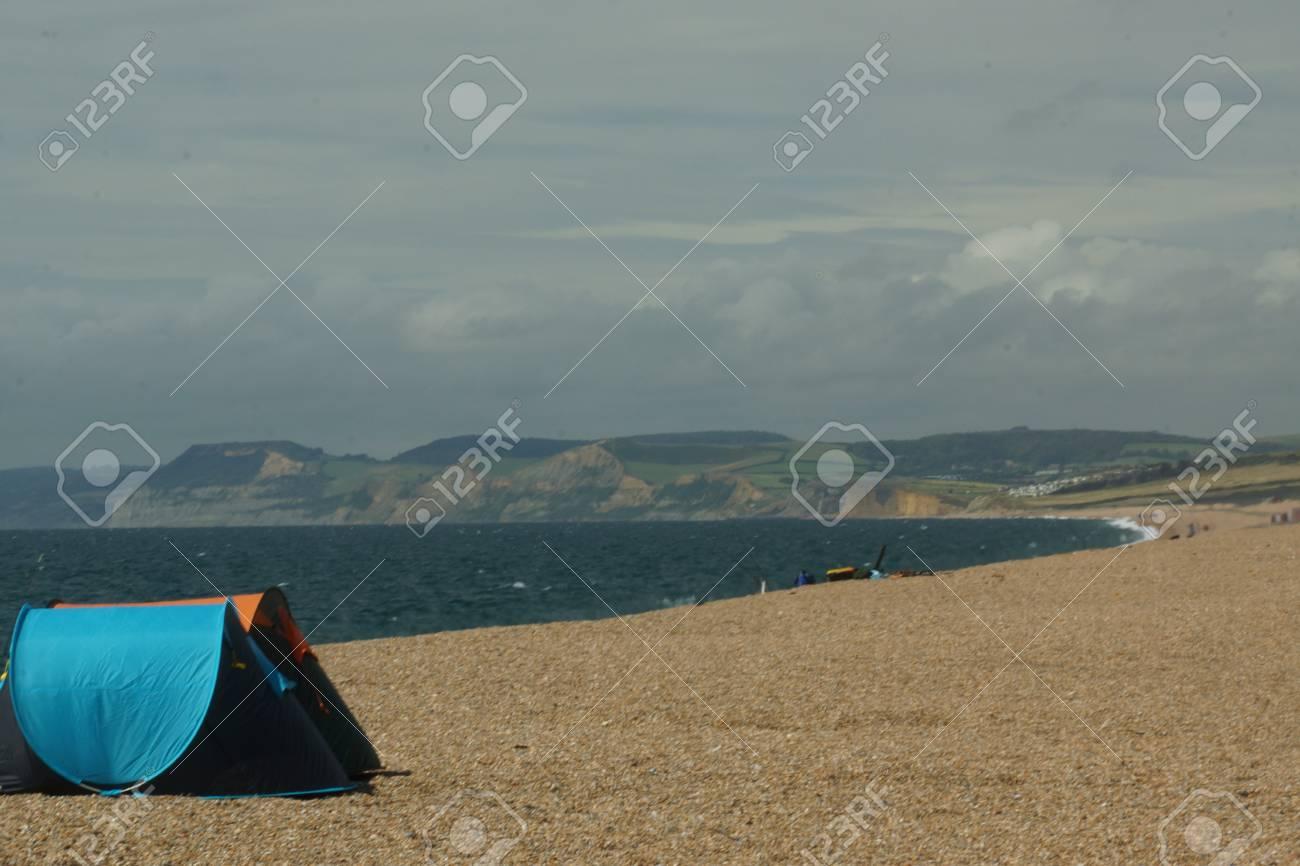 Beach tents on an overcast day on Chesil Beach in Dorset UK Stock Photo - & Beach Tents On An Overcast Day On Chesil Beach In Dorset UK Stock ...