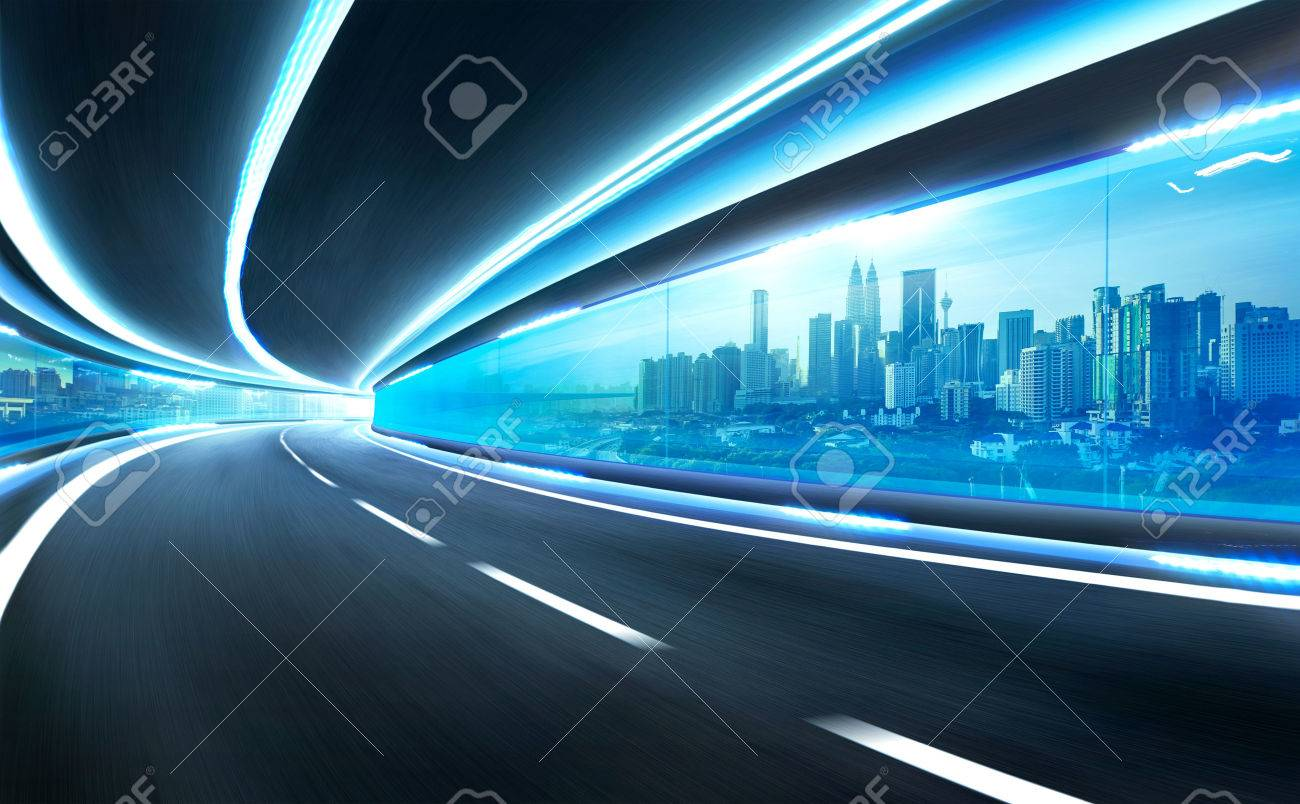 Abstract blurred speed motion road in glass tunnel over the city - 51643818