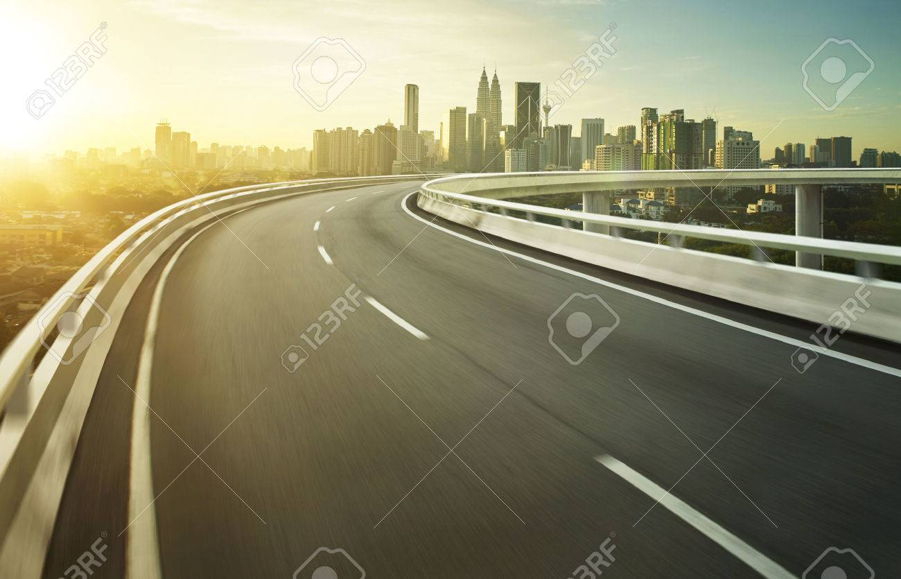 Highway overpass motion blur with city background . - 55263956