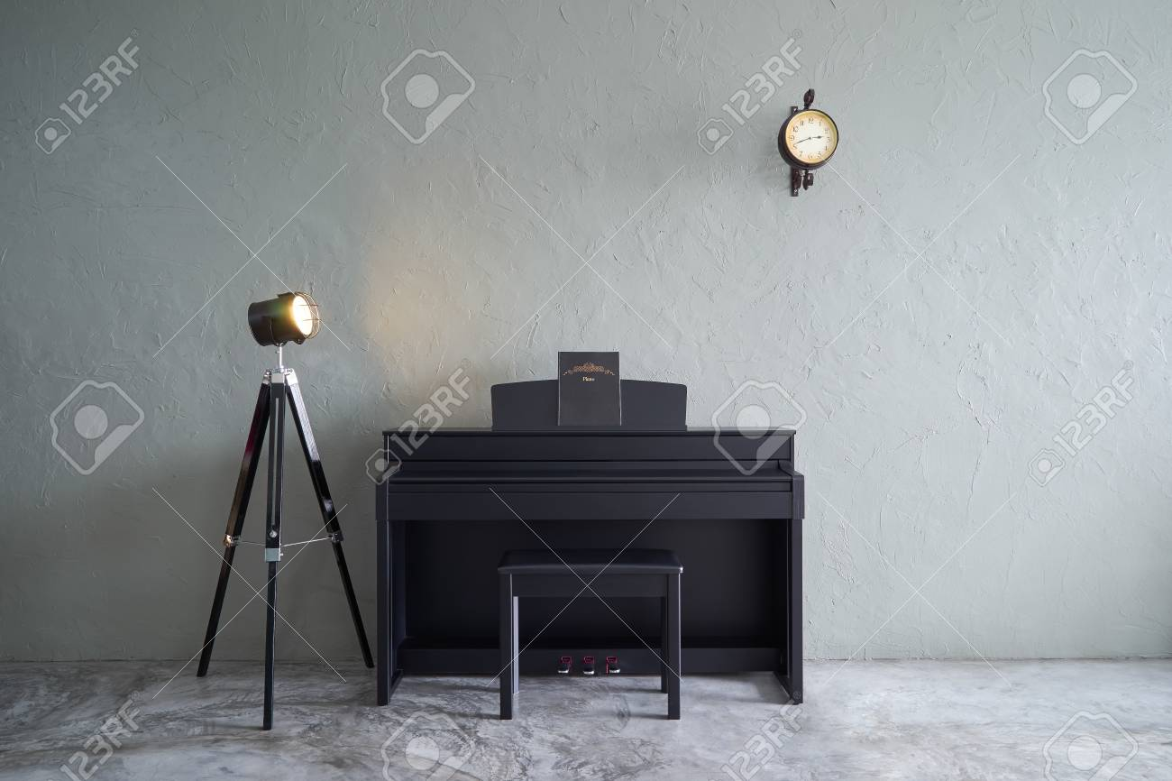 Modern Living Room With Piano,clock And Lamp Stand . Cement Floor And  Concrete Wall
