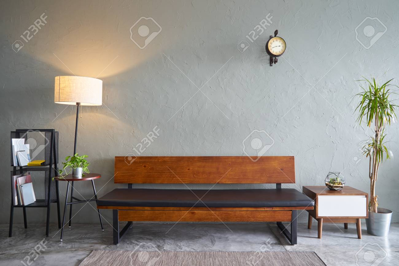 Modern living room with wooden bench sofa ,green plant , wooden..