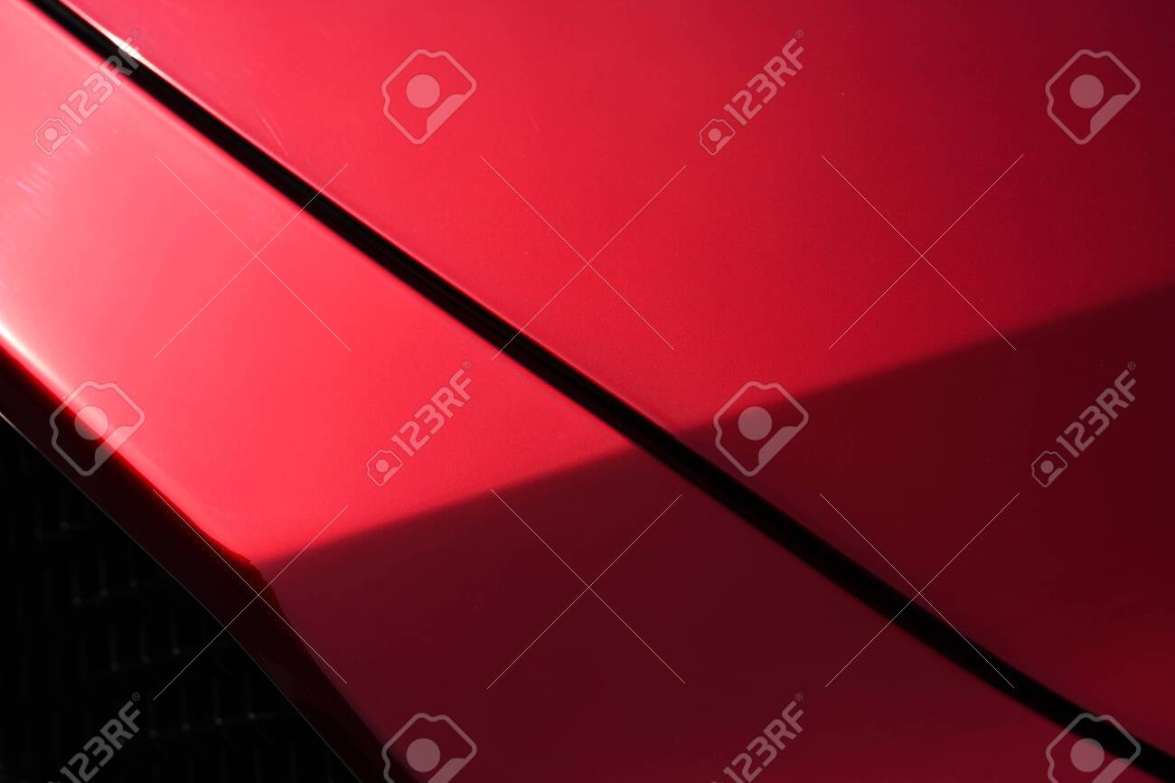 Close up detail of red metallic paint coating car body - 129496384