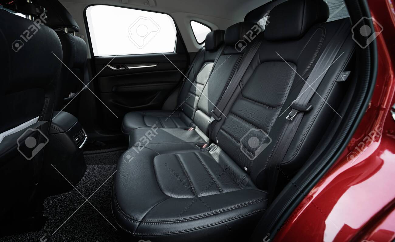 Closeup of a modern car interior with the black leather rear seats - 129496445
