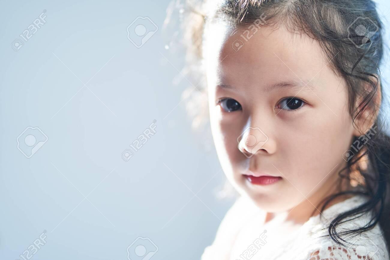 Closeup portrait of pretty little asian girl - 140194489