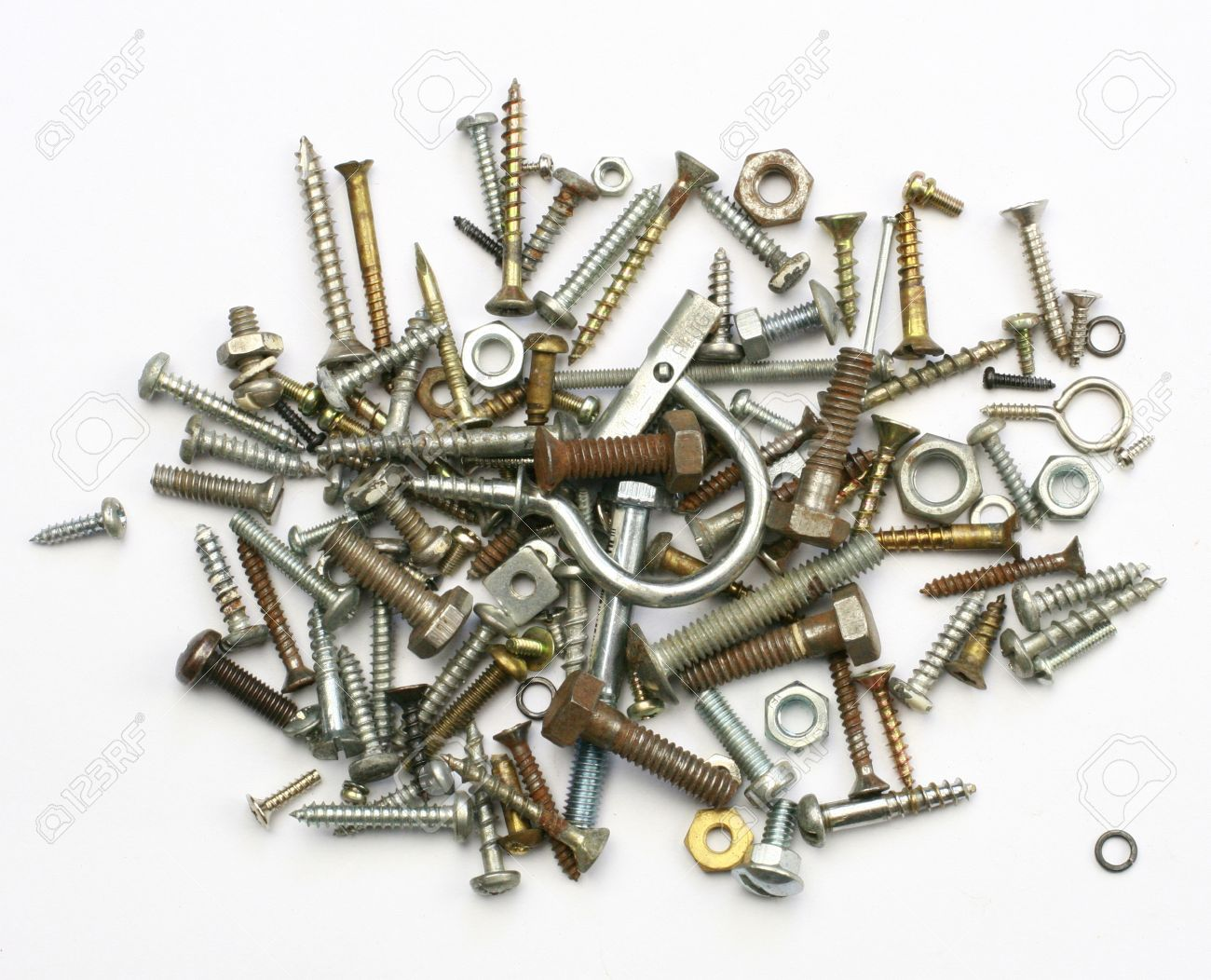 A Pile Of Nuts Bolts Screws And Other Fasteners On A White Background Stock Photo Picture And Royalty Free Image Image 47651092