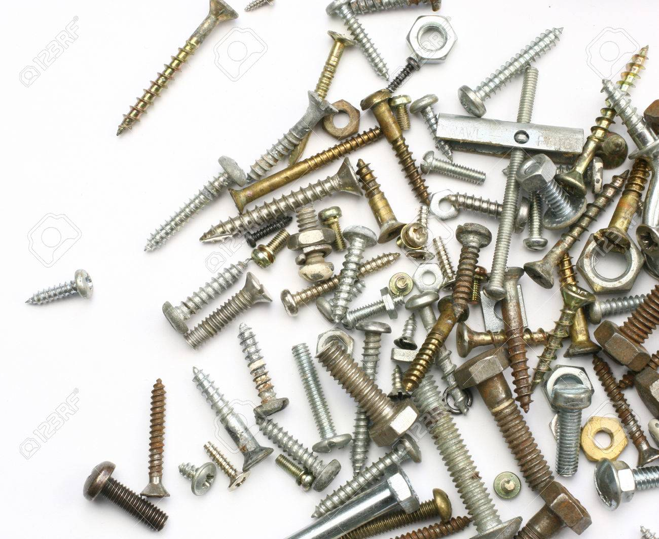 A Pile Of Nuts Bolts Screws And Other Fasteners On A White Background Stock Photo Picture And Royalty Free Image Image 47651259