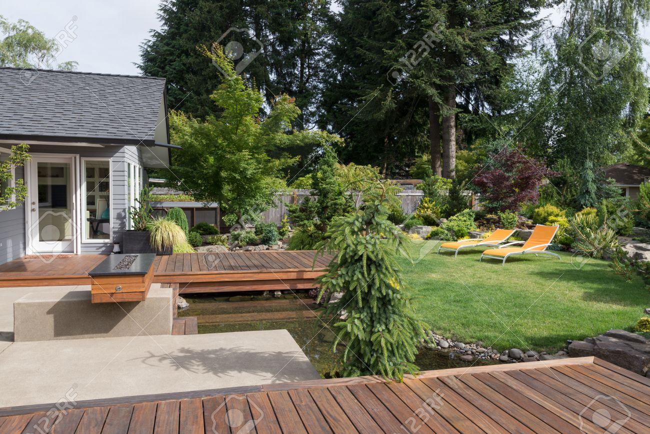 back yard of a modern pacific northwest home featuring a deck