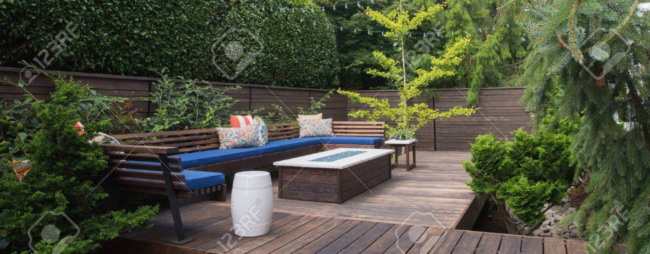 Panorama of a contemporary outdoor conversation inspired by oriental design. - 62392910