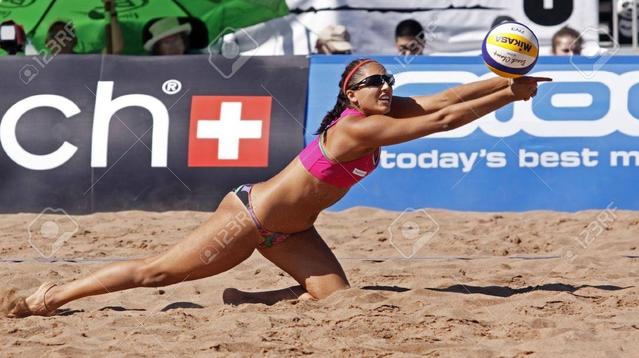 HALIFAX, CANADA - SEPTEMBER 3, 2011 - Victoria Altomare of Canada reaches for the ball at the FIVB Beach Volleyball Swatch Junior World Championships on Sept. 3, 2011 in Halifax, Canada. Stock Photo - 10677878