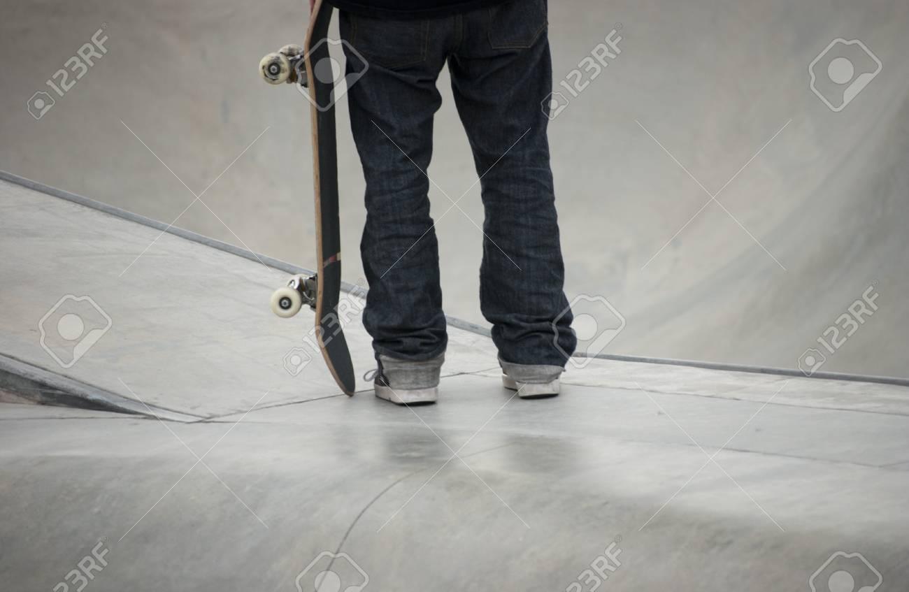 Teenager holding his skateboard at local skatepark Stock Photo - 7453055