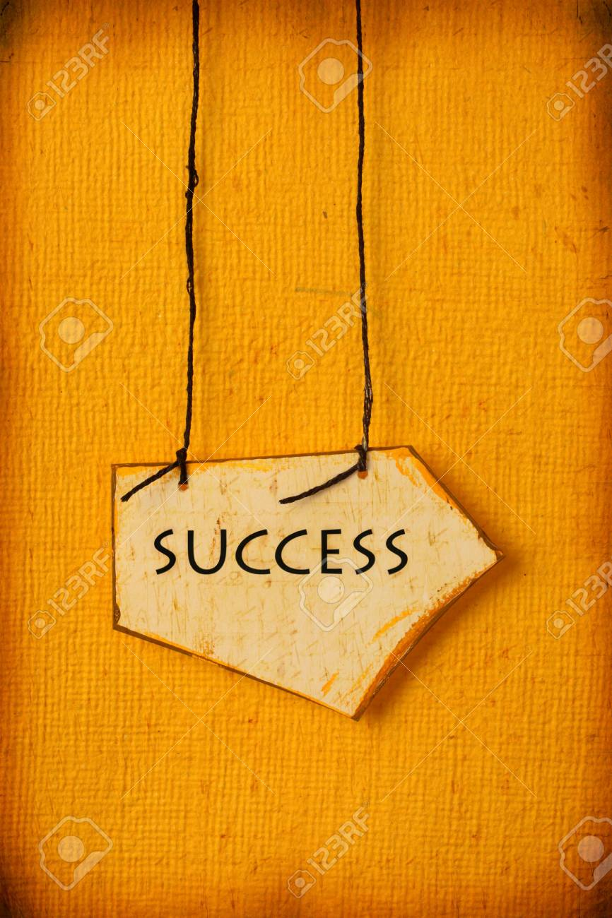 Close up of handmade paper tag with success word Stock Photo - 5954652