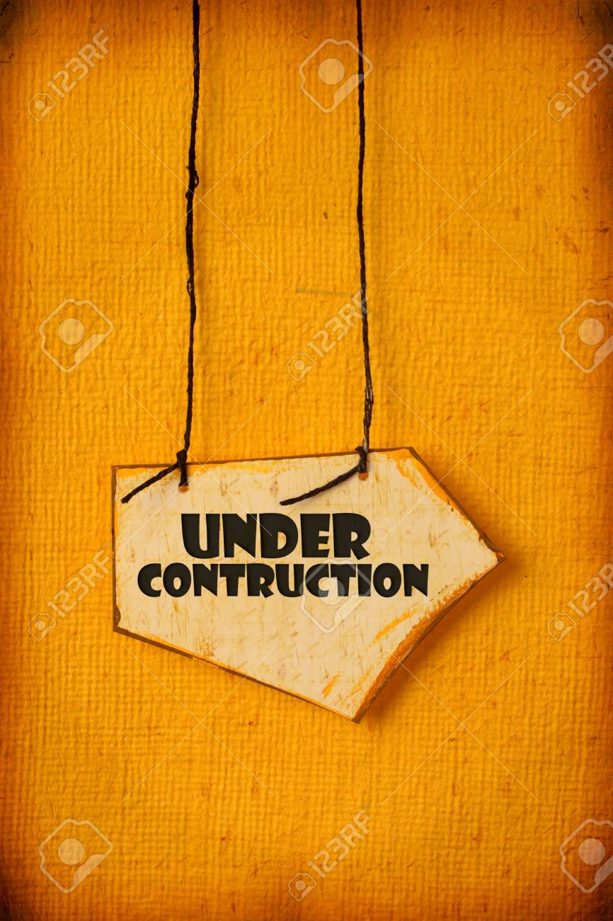 Close up of handmade paper tag with UNDER CONTRCTION Stock Photo - 5986347