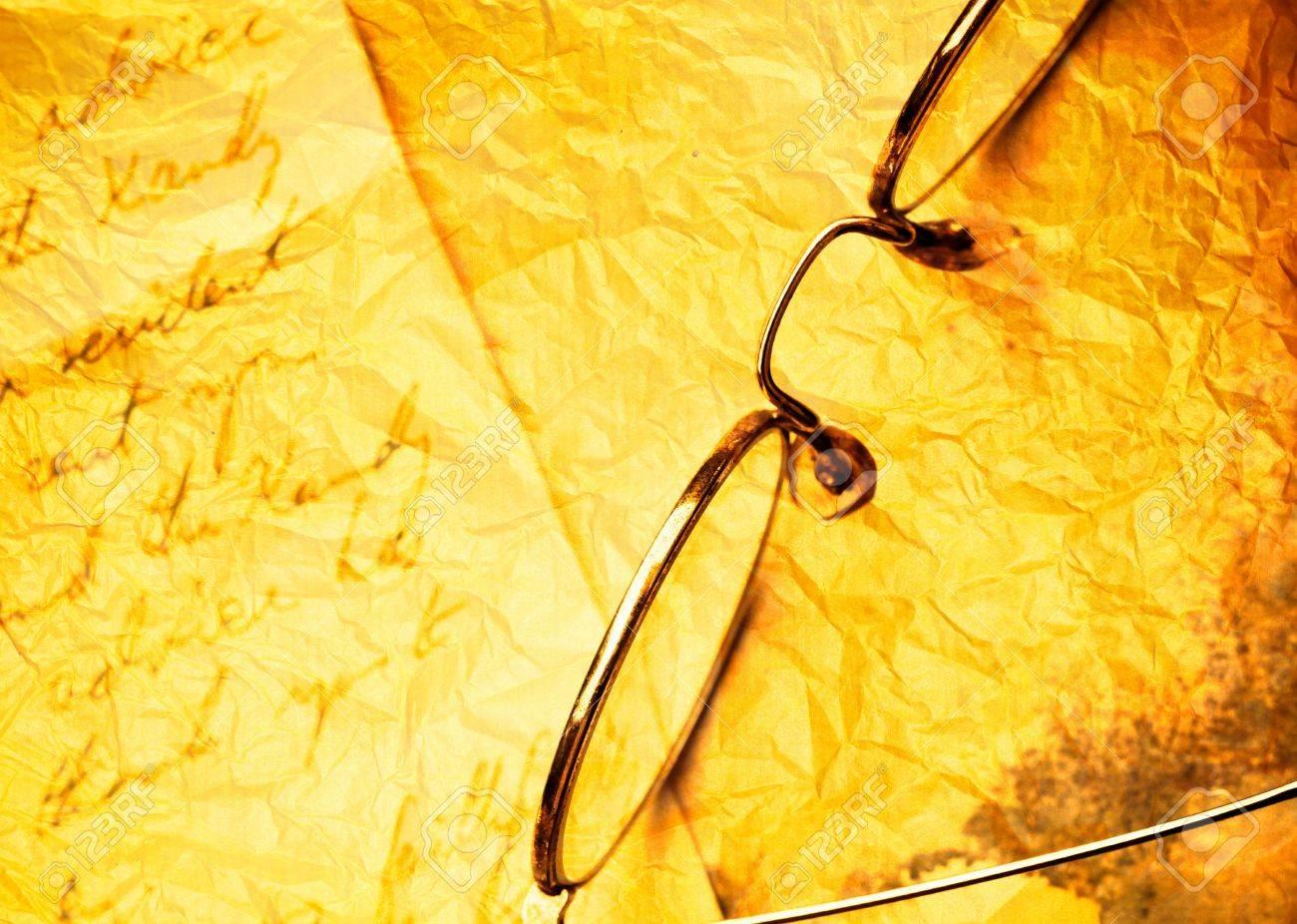 close up of Vintage paper background with old eyeglasses - 10764949