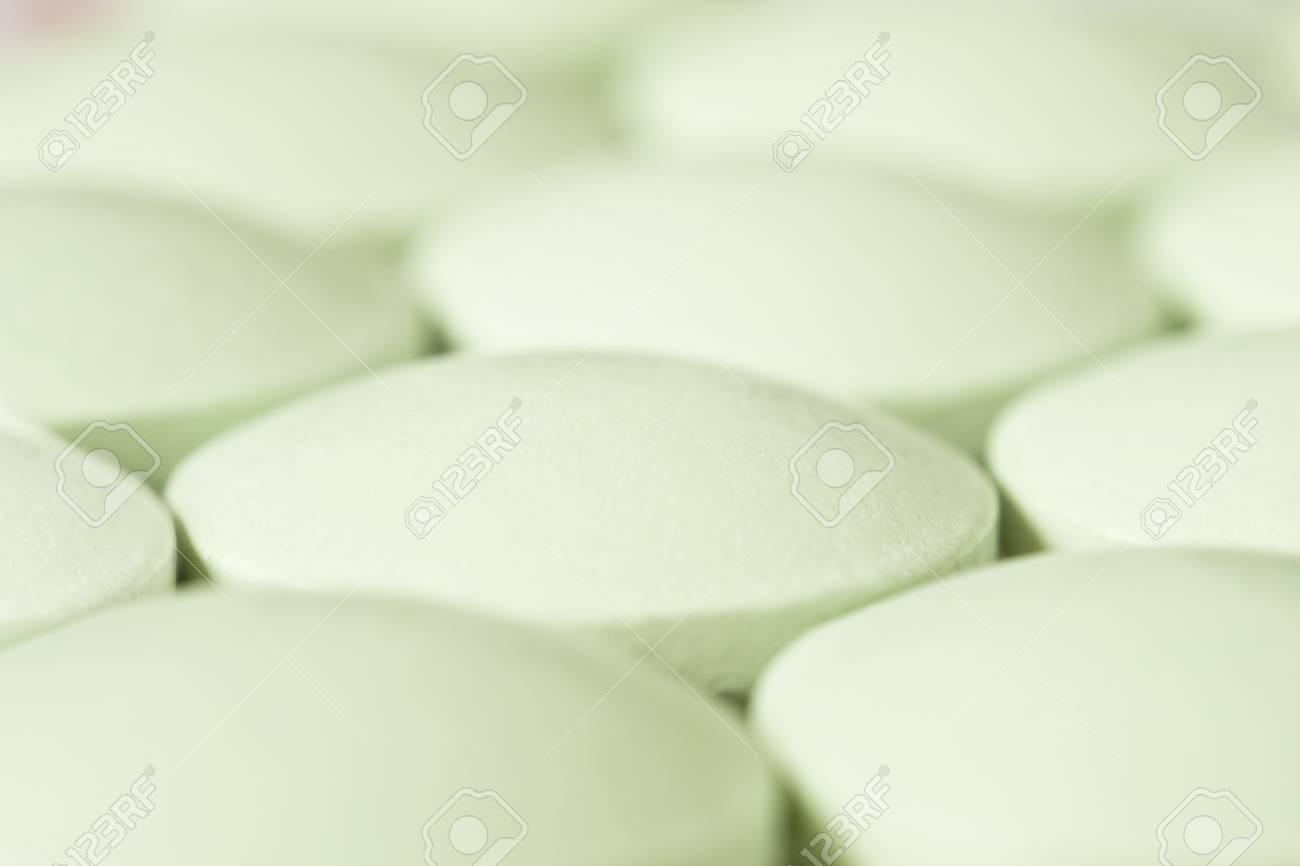 Lots of vitamin pills on conveyor belt at pharmaceutics production line Stock Photo - 9590270