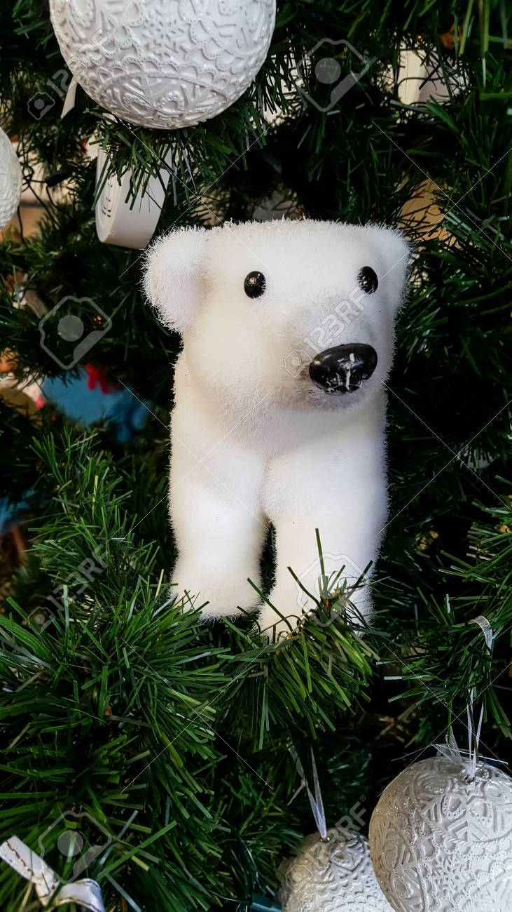 polar bear decoration in xmas tree with other decorations stock photo 90427702