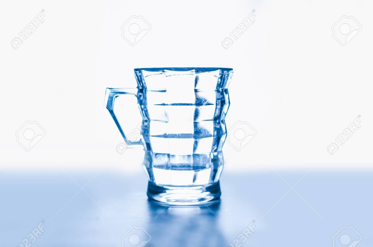 fb8498a725f Empty glass isolated on a white background Stock Photo - 86794925