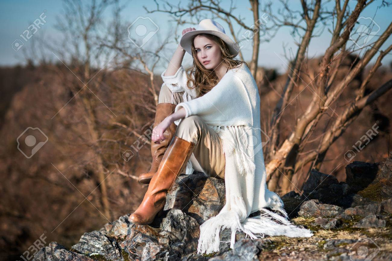 Fashion woman in country style sitting on the canyon rock - 38034670
