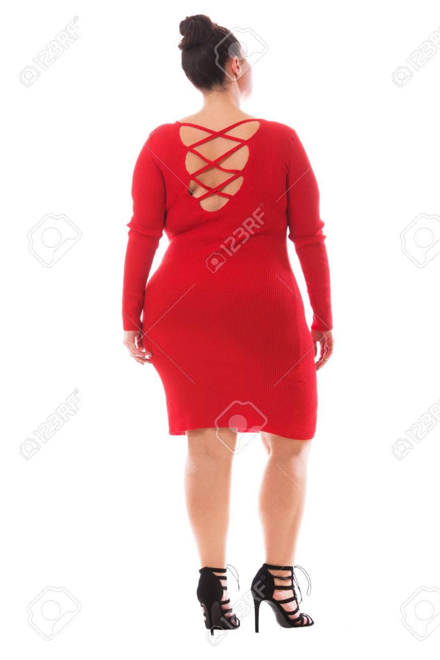 Full-length portrait of beutiful plus size model woman wearing..