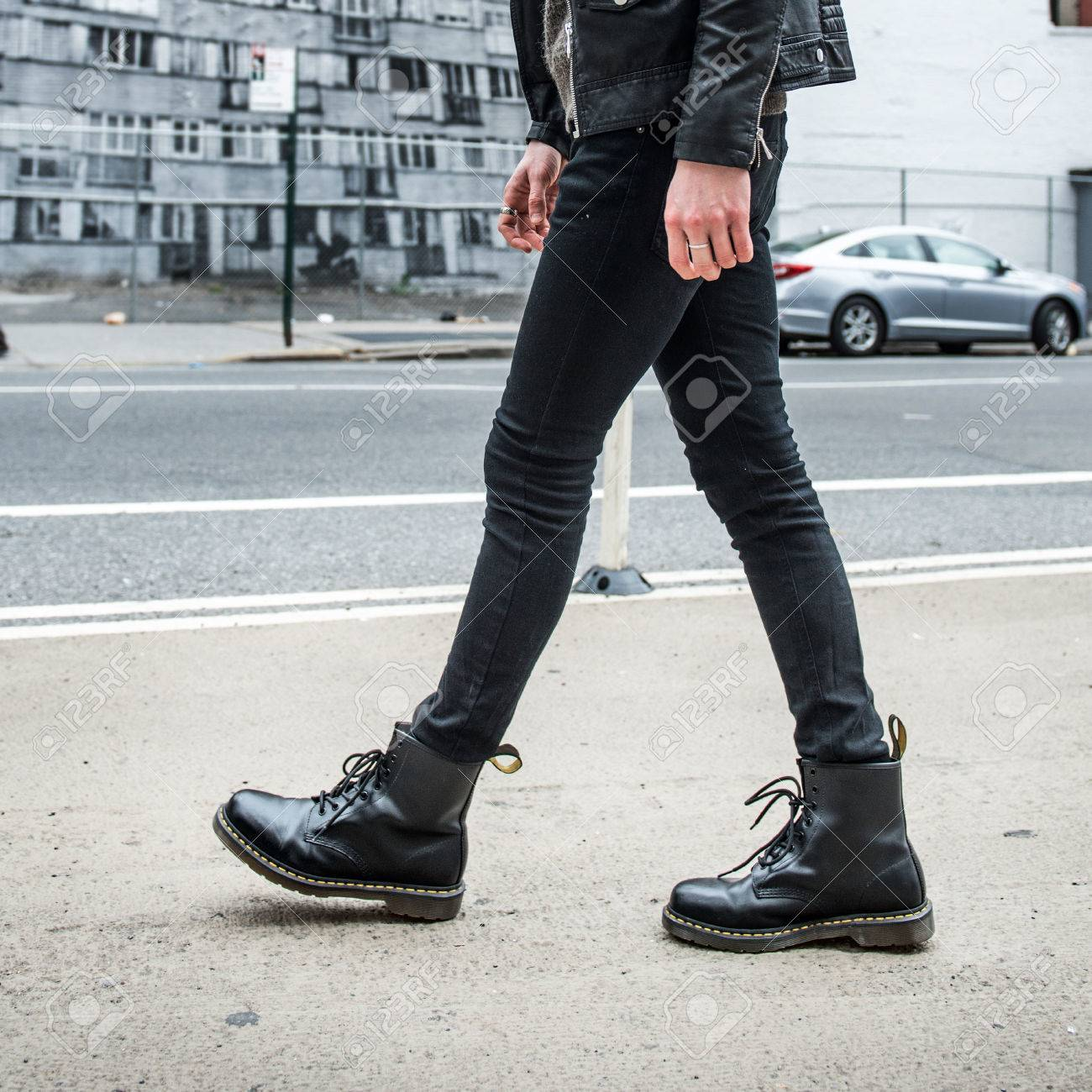 Men fashion concept. Man wear black stylish leather boots and..
