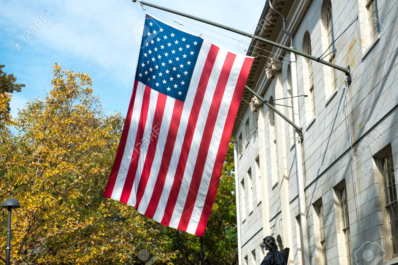 American flag on the college campus building