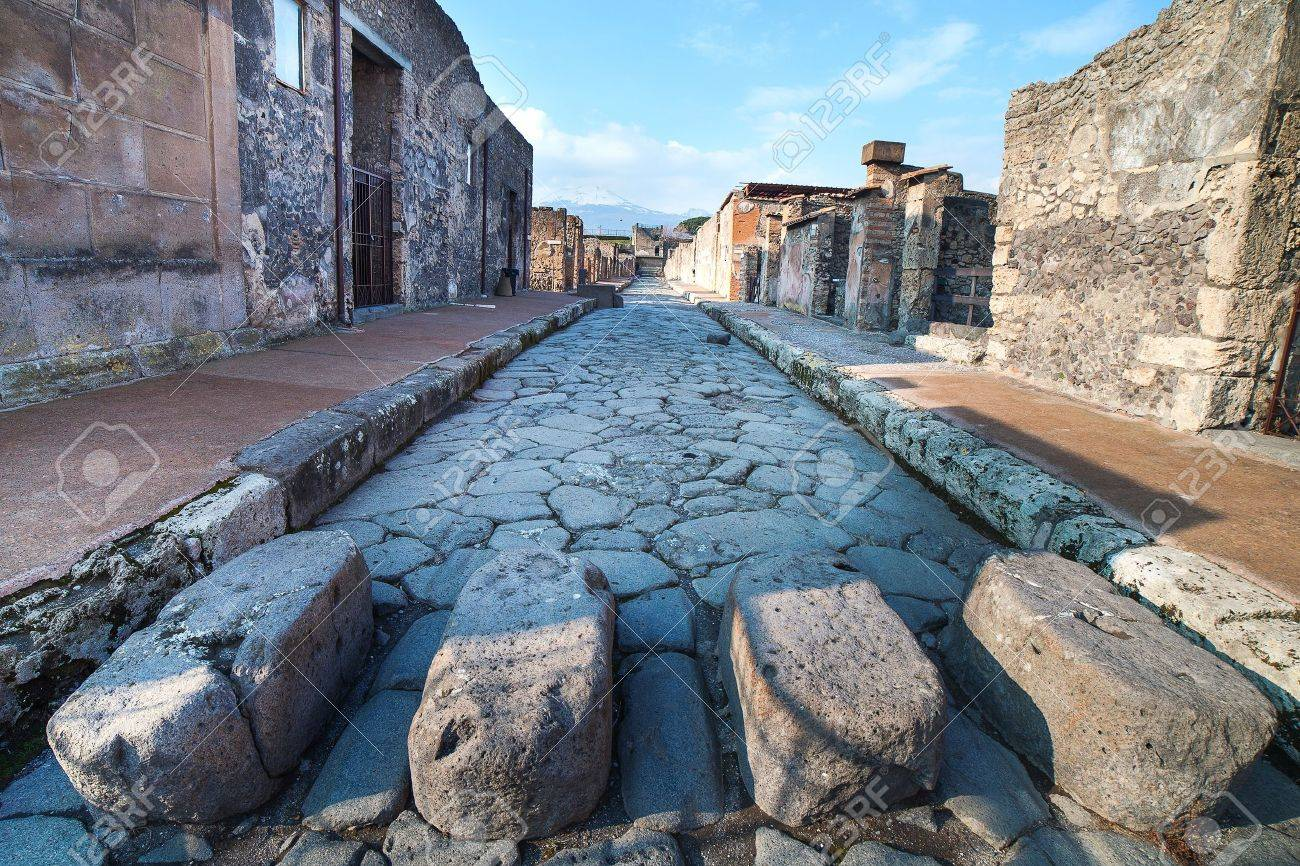 17652280-Street-in-ancient-roman-city-Pompeii-Italy--Stock-Photo.jpg