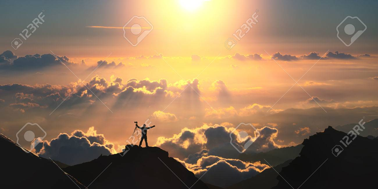 A man standing on the top of the mountain above the clouds. - 41903207