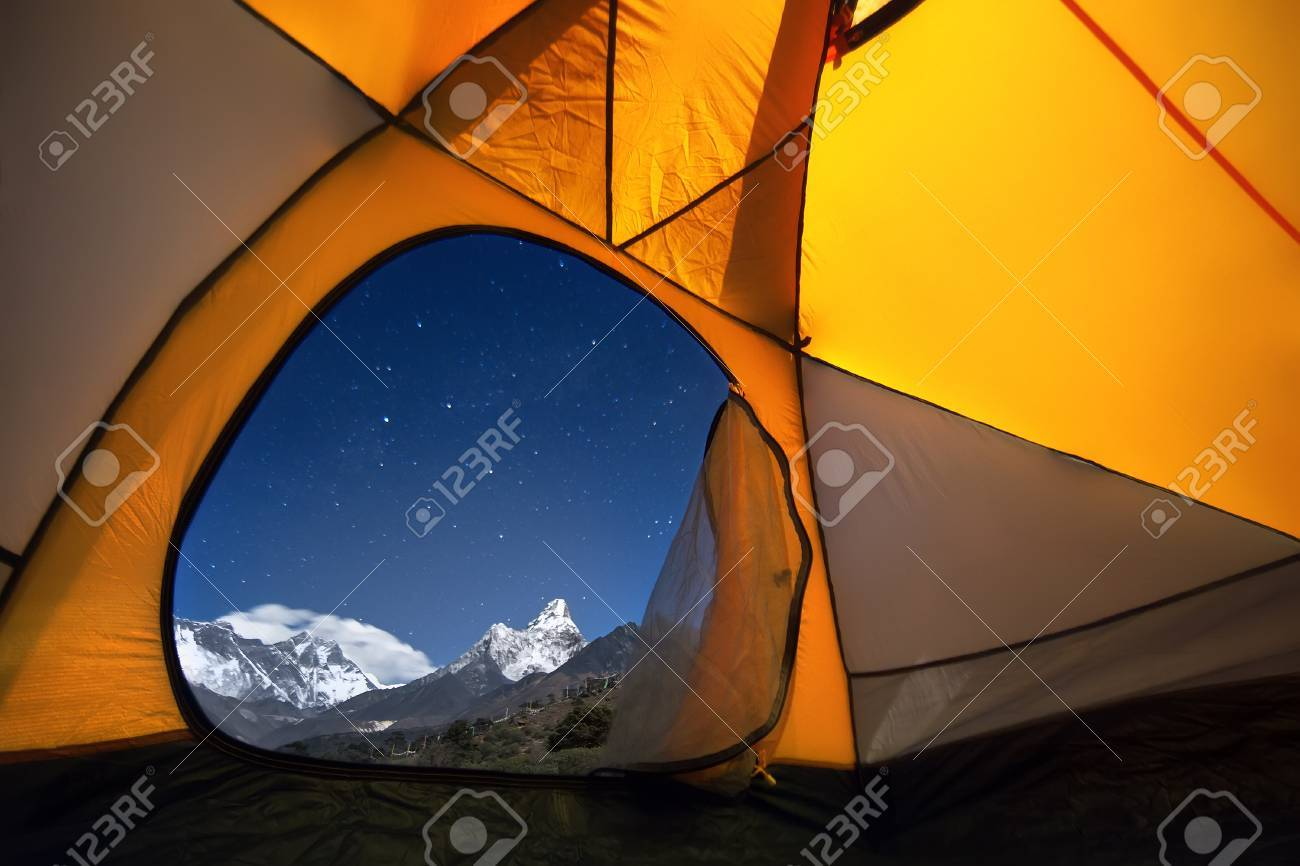 View of the mountains from a tourist tent. From the «window» of the tent from left to right there are two eight-thousanders - Mt. Everest (8,848 m), Lhotse (8,516 m) and Ama Dablam (6,814 m). - 56271678