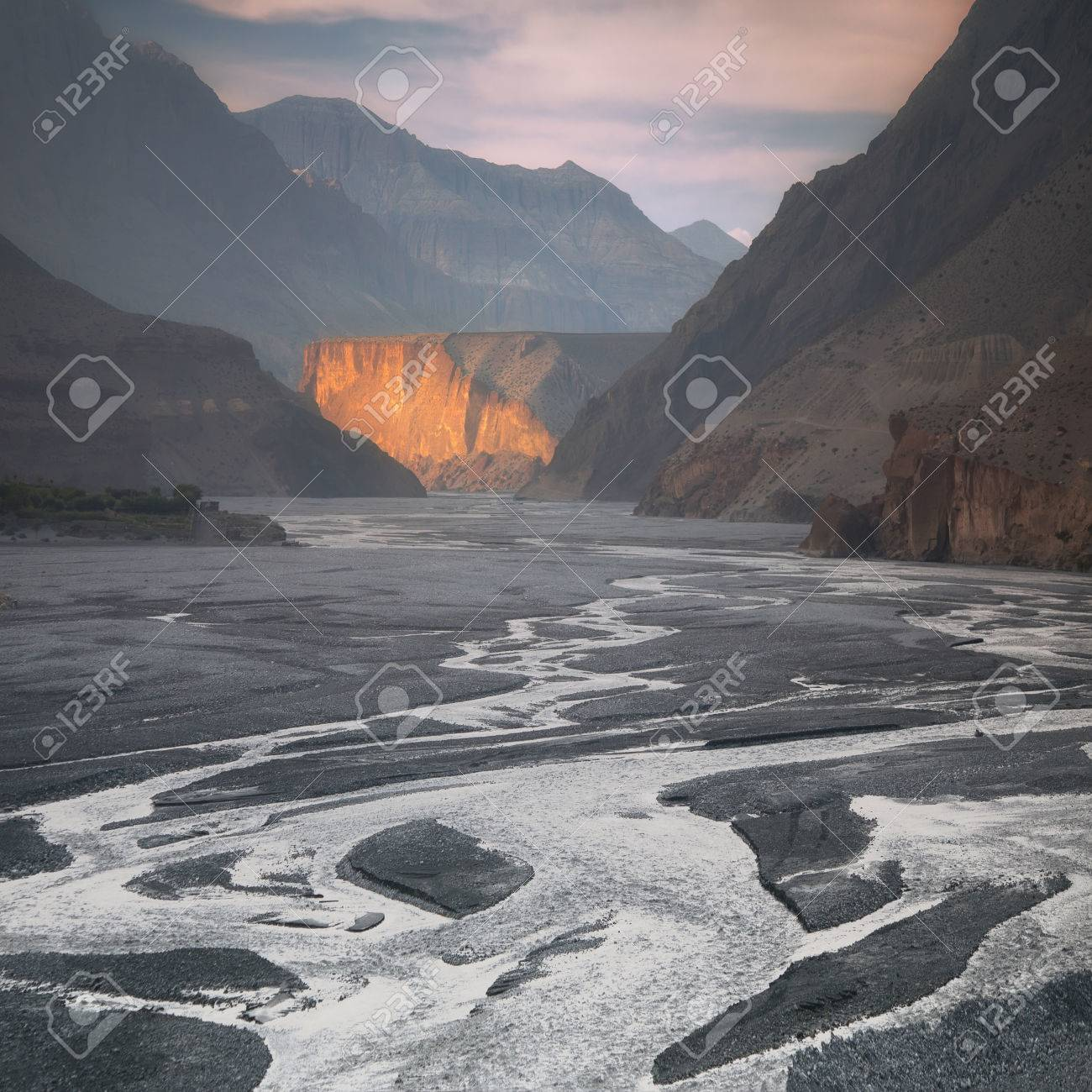 Nepal, Upper Mustang, the last sunrays in the gorge of Kali Gandaki river, the deepest gorge in the world - 82857584