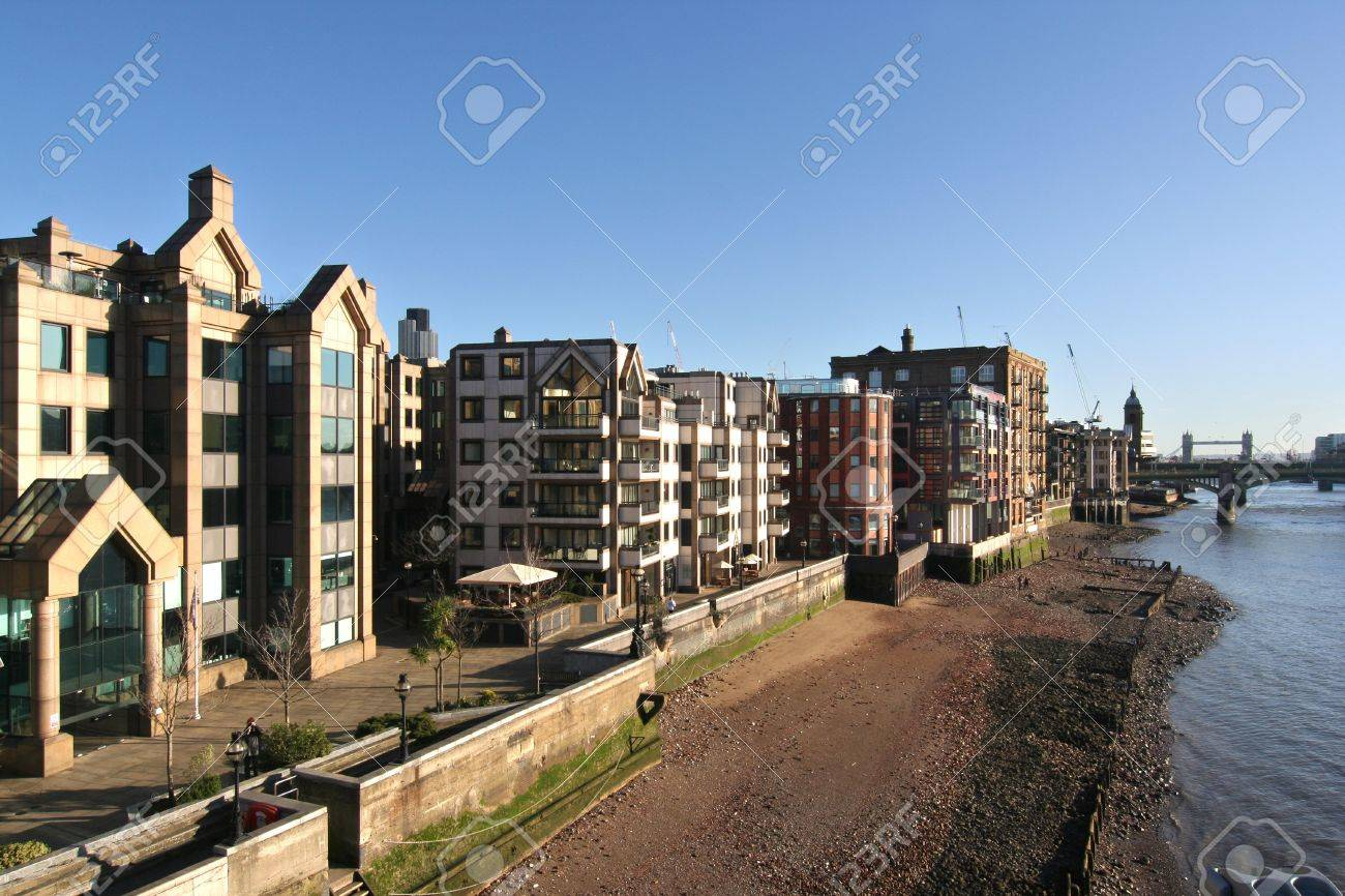 City office buildings and Thames Path along the north bank of the Thames Stock Photo - 4574921