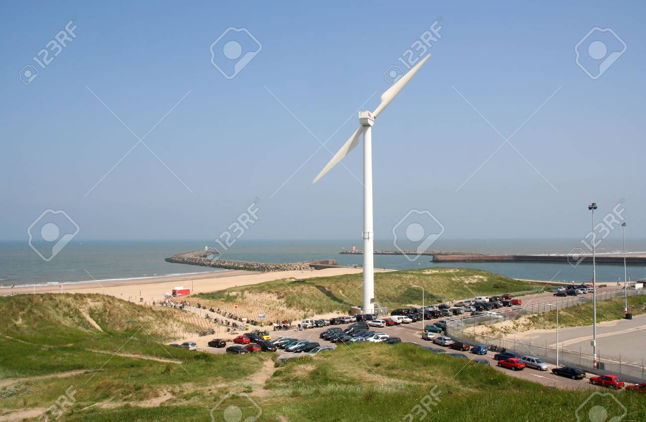 Wind turbine in the dunes, with north sea in the background Stock Photo - 4730491