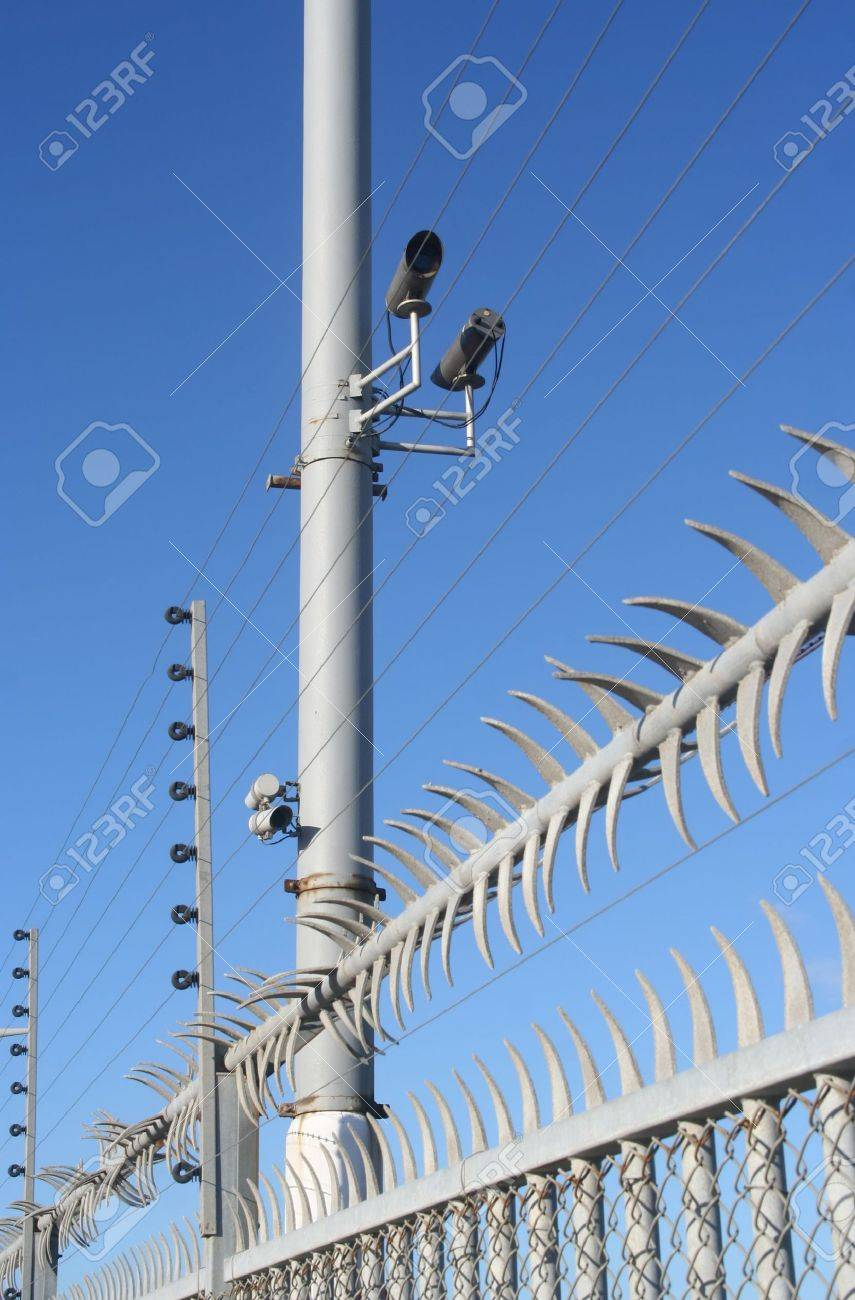 High security fence with video cameras and electric wire Stock Photo - 5347598