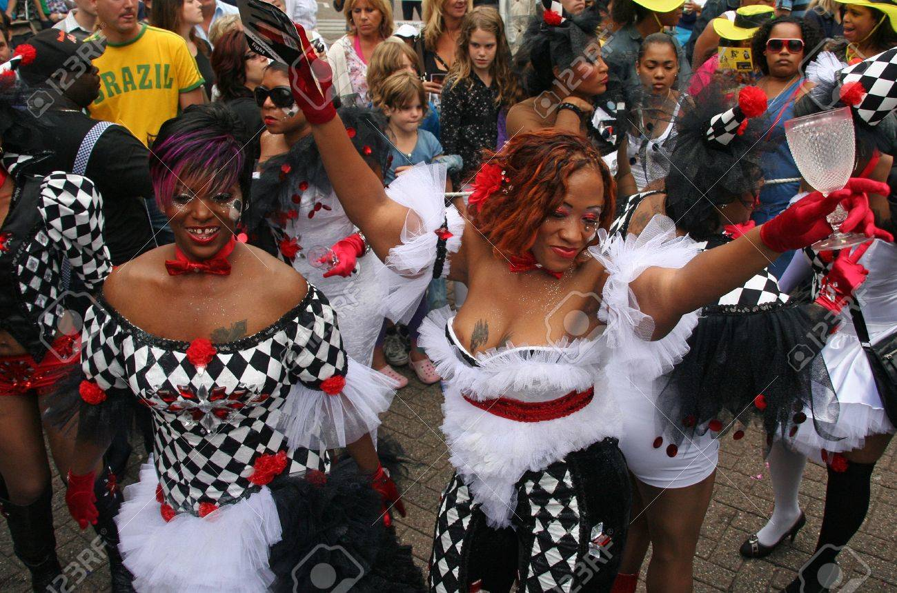 ROTTERDAM, HOLLAND - JULY 31, 2010: Party people in the parade of the annual Summer Carnival in Rotterdam on July 31, 2010 in Rotterdam, Holland Stock Photo - 7525700