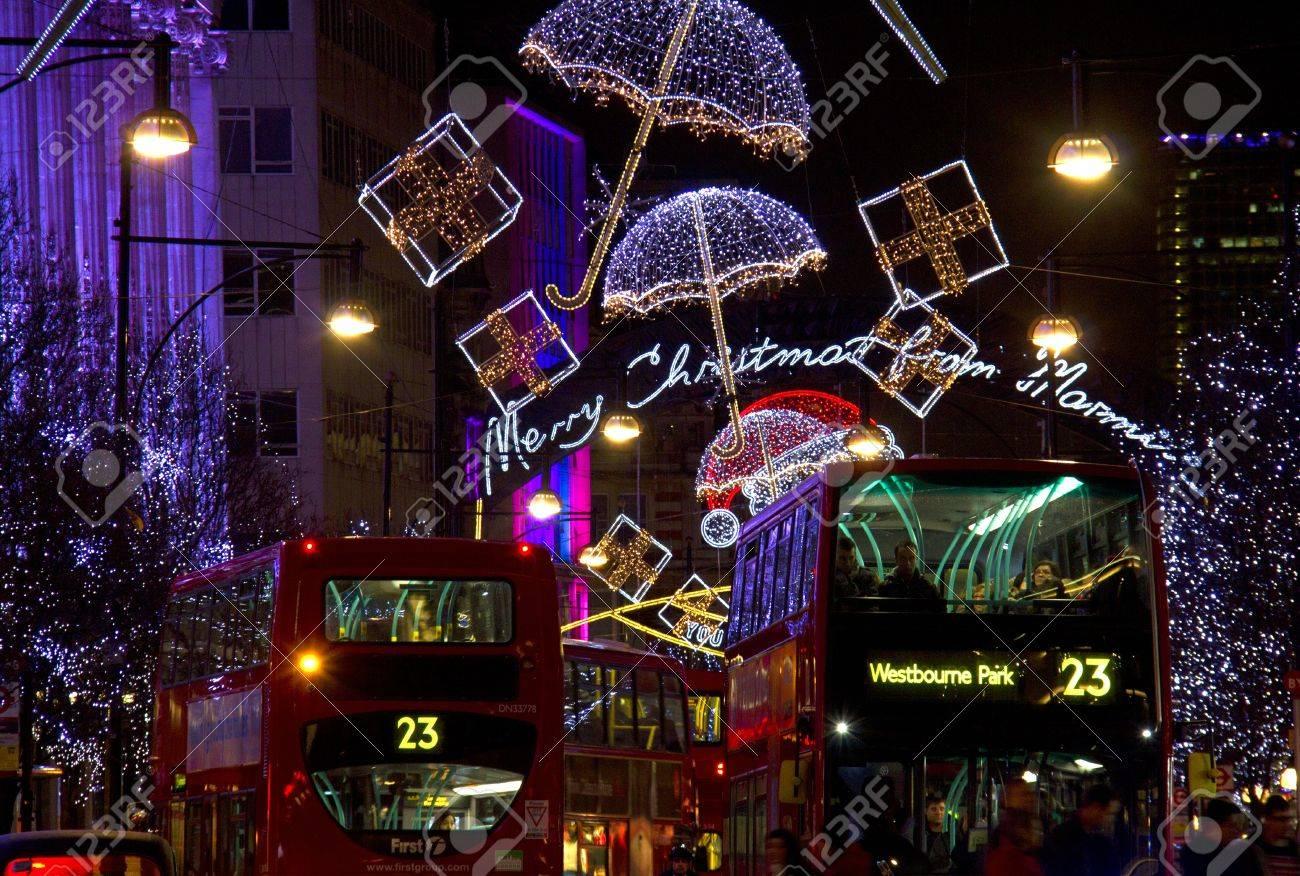 London, UK - December 29, 2012: Double decker busses ride through Regent Street decorated for Christmas in London, UK on December 29, 2012 Stock Photo - 17765175