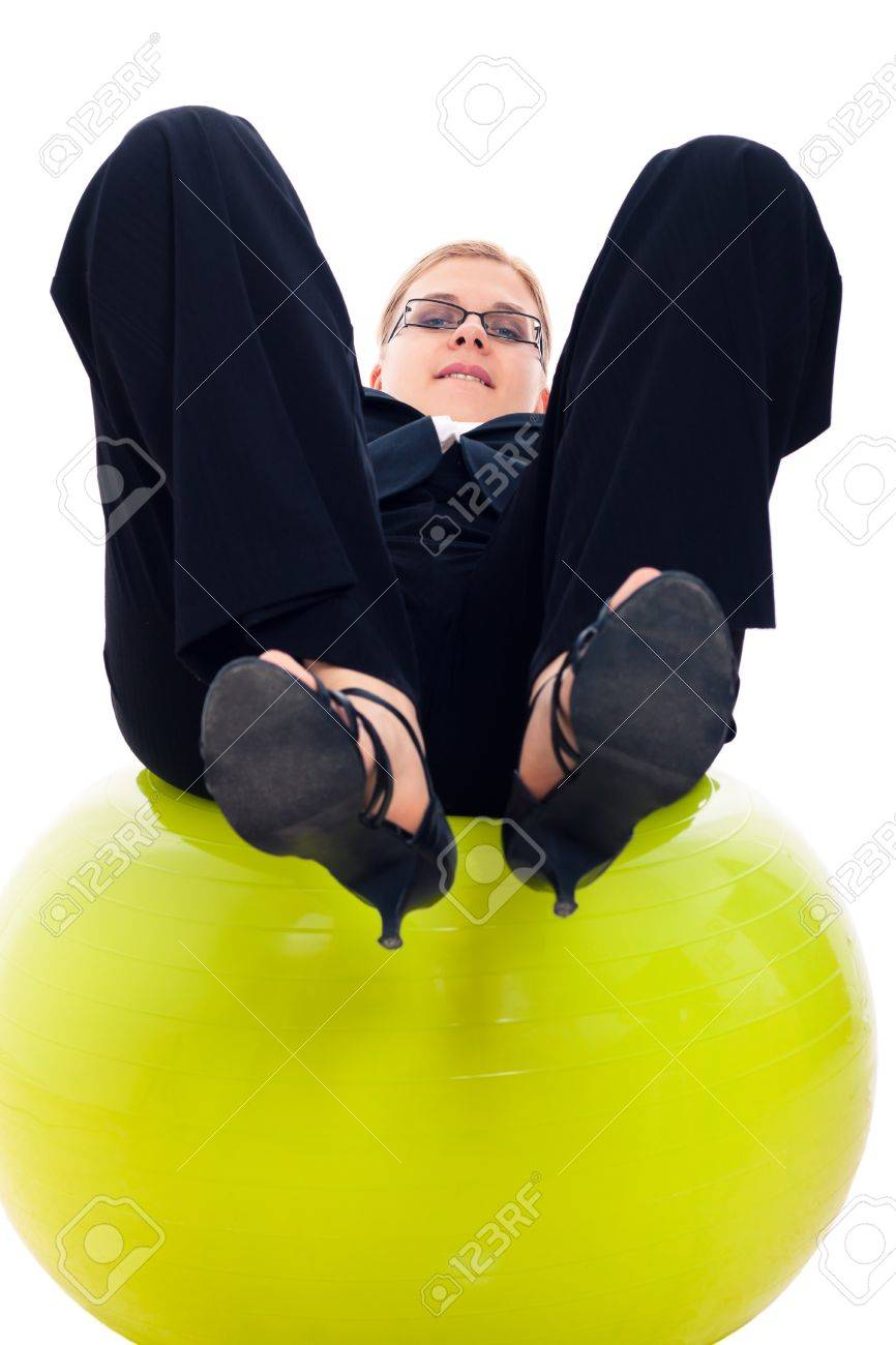 Businesswoman having fun on green exercise ball, isolated on white background. Stock Photo - 13712122