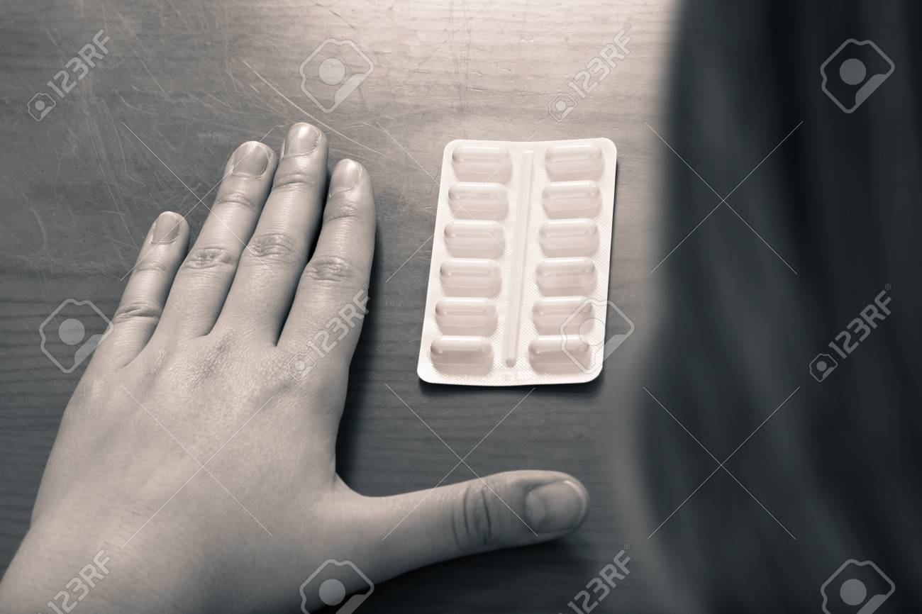 Dramatic photo of female hand and pills, medicine addiction concept. Stock Photo - 15152712