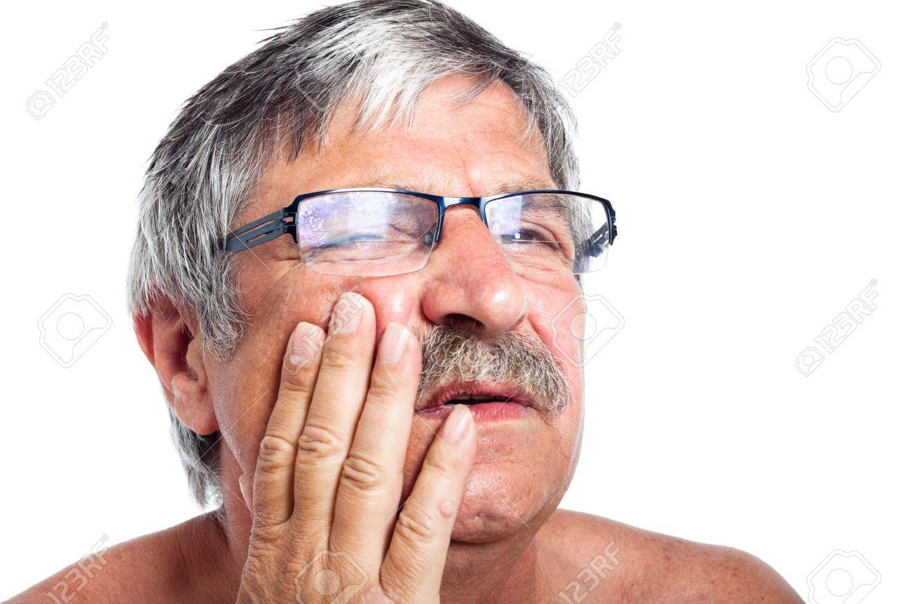 Close up of unhappy senior man with painful toothache, isolated on white background. - 15288415