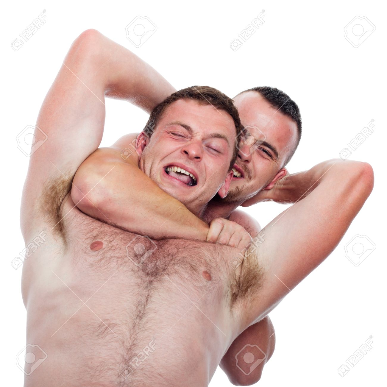 Two shirtless men fighting and wrestling, isolated on white background. Stock Photo - 15288347