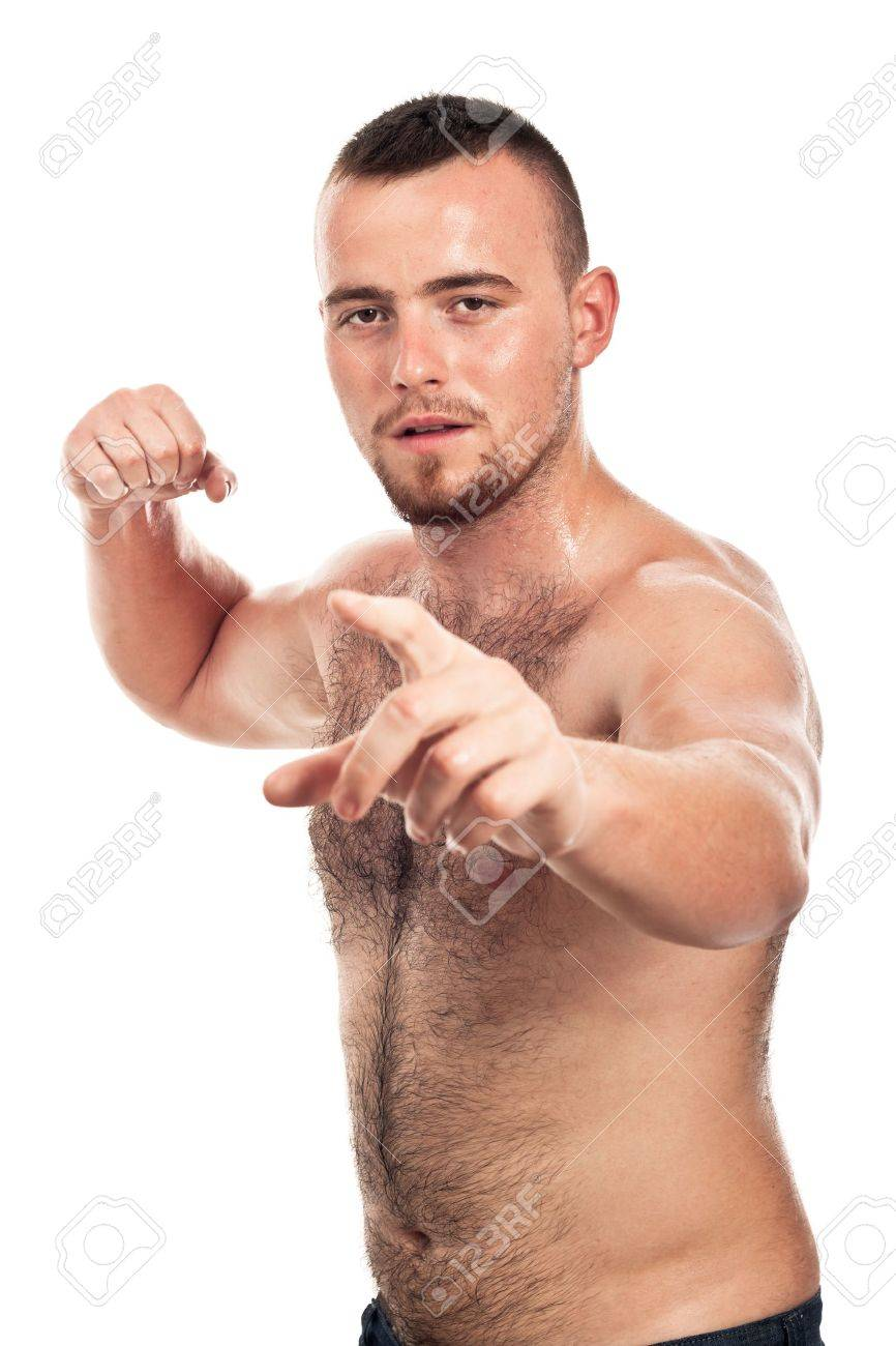 Portrait of young shirtless male fighter pointing at you, isolated on white background. Stock Photo - 15572363