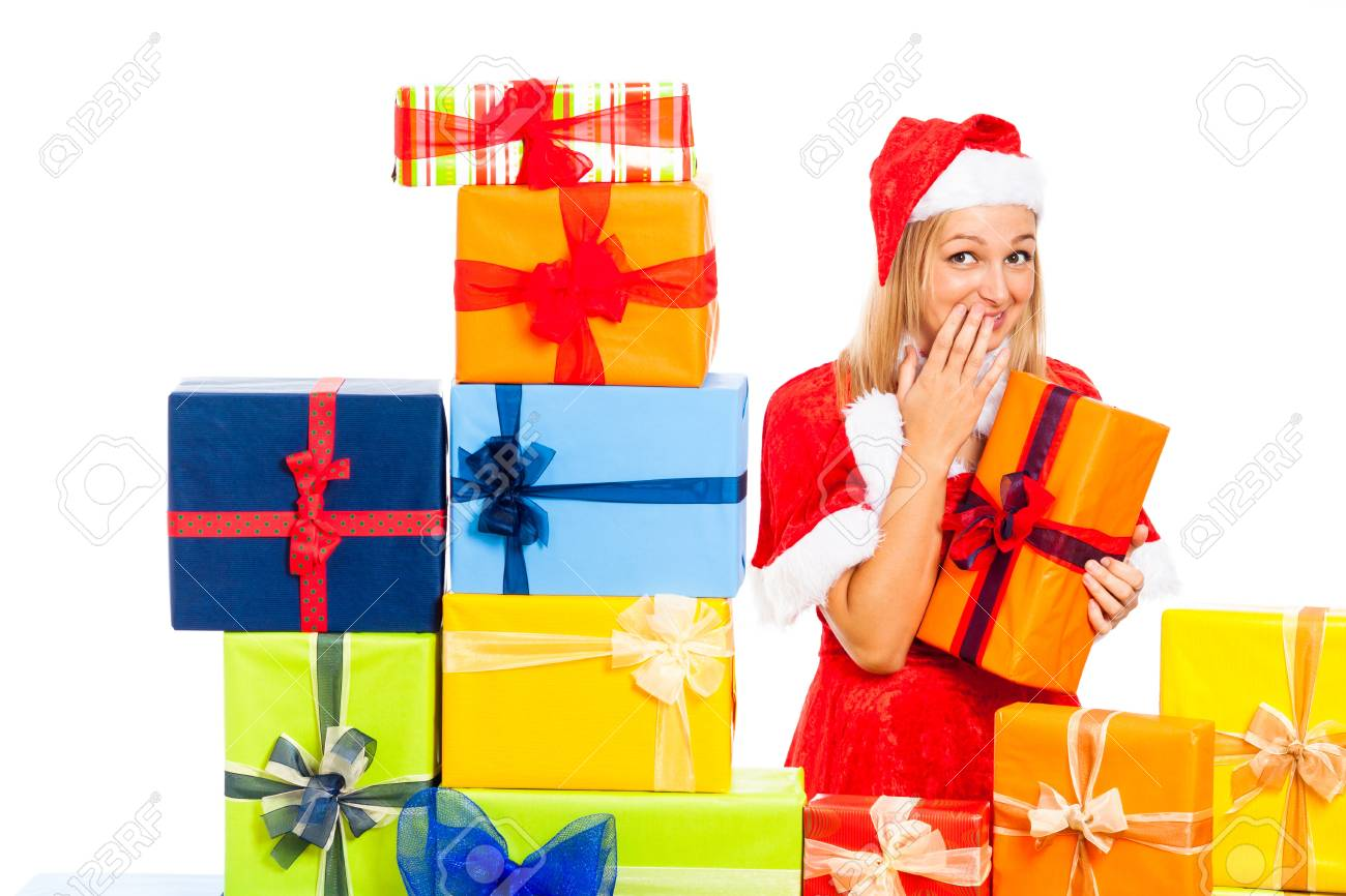 Young beautiful blond cute woman in Santa costume with Christmas gift boxes, isolated on white background. Stock Photo - 16008544