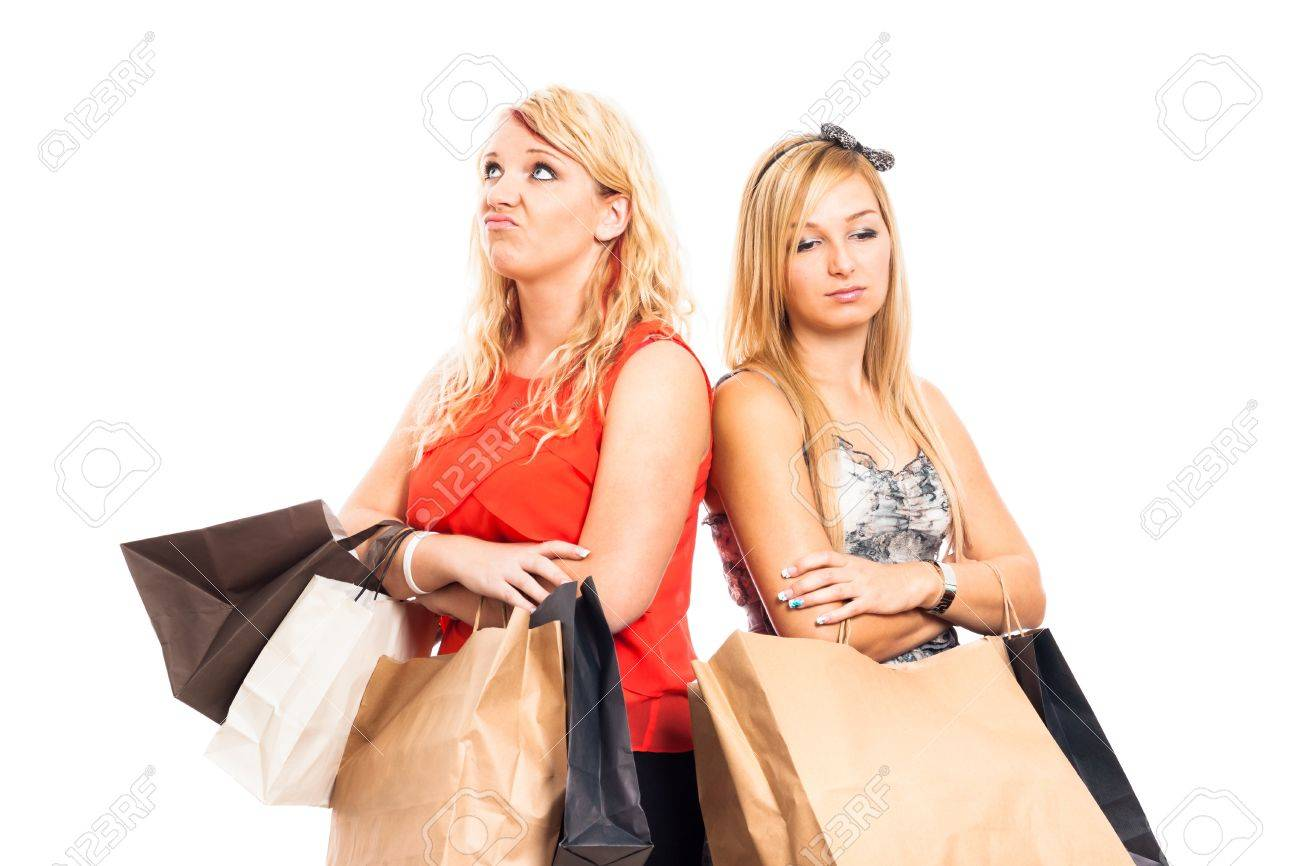 Two young blond unhappy women holding shopping bags, isolated on white background - 16120479