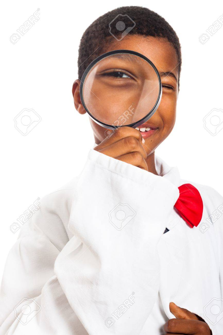 Happy clever scientist school boy with magnifying glass, isolated on white background. - 16250153