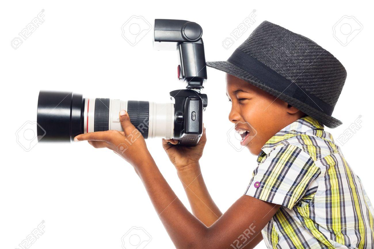 Child boy taking photo with professional camera, isolated on white background. - 16250150