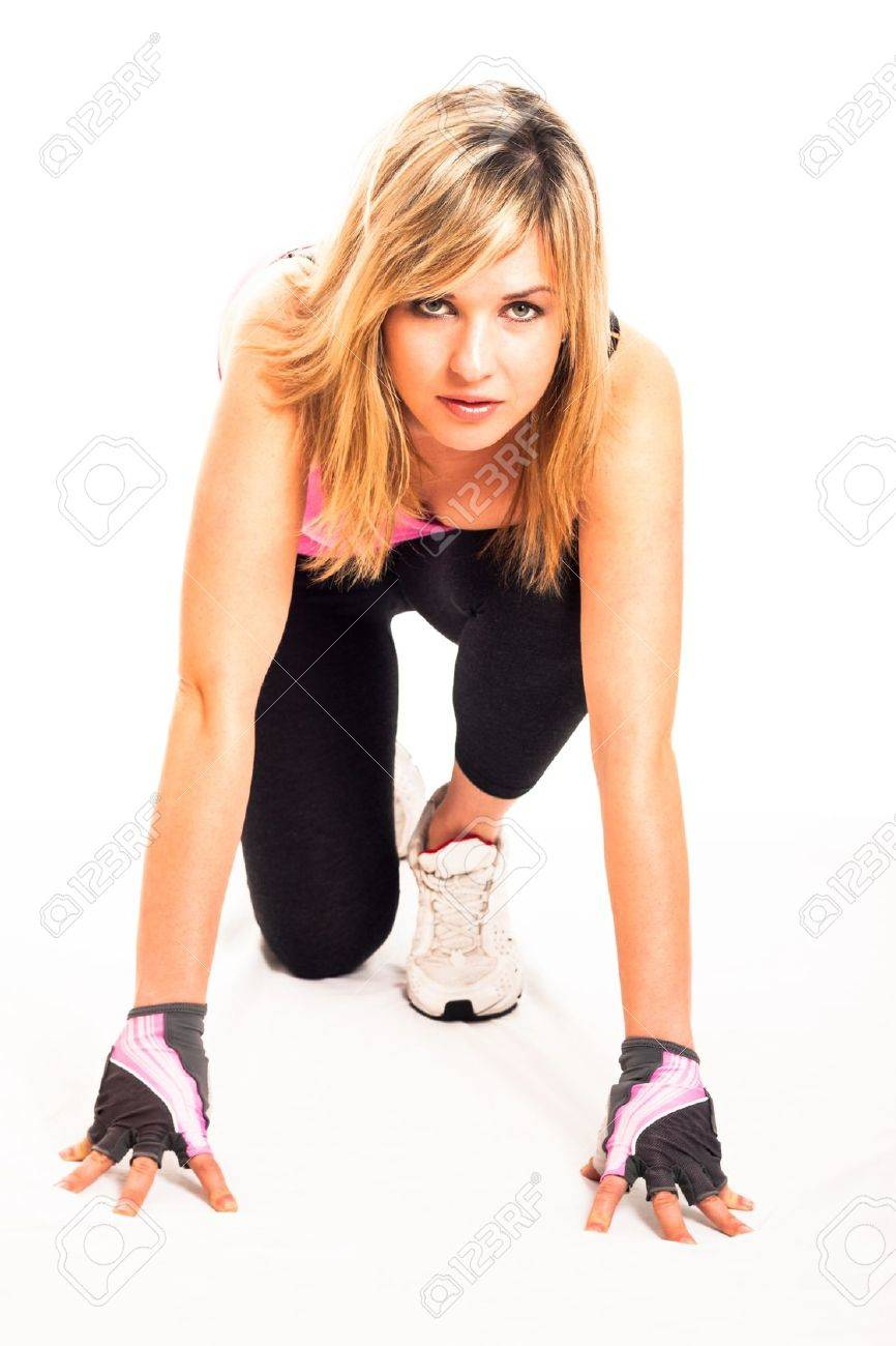 Young beautiful sporty woman ready to run, isolated on white background. - 16405875
