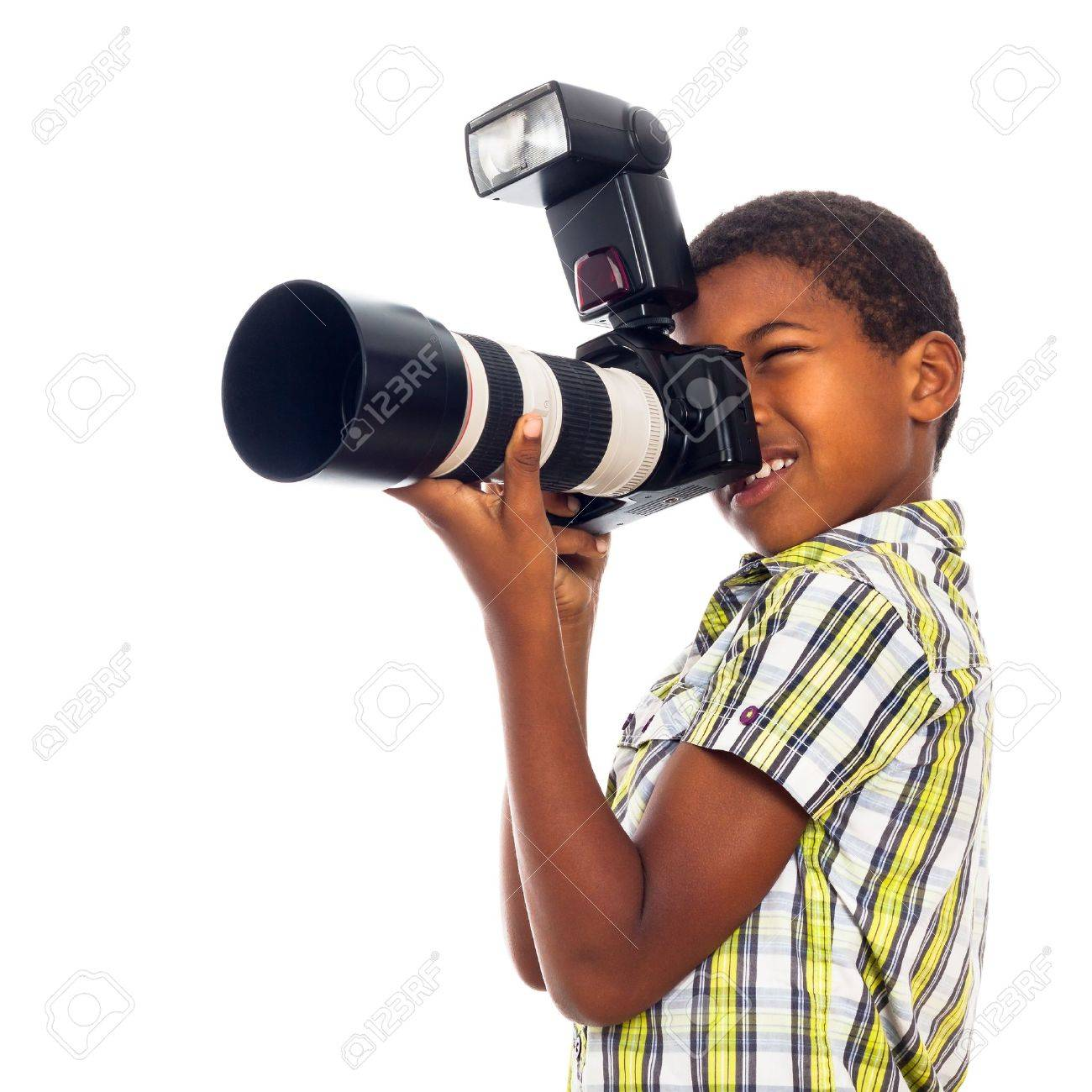 Child school boy taking photos with professional camera, isolated on white background. - 16959457